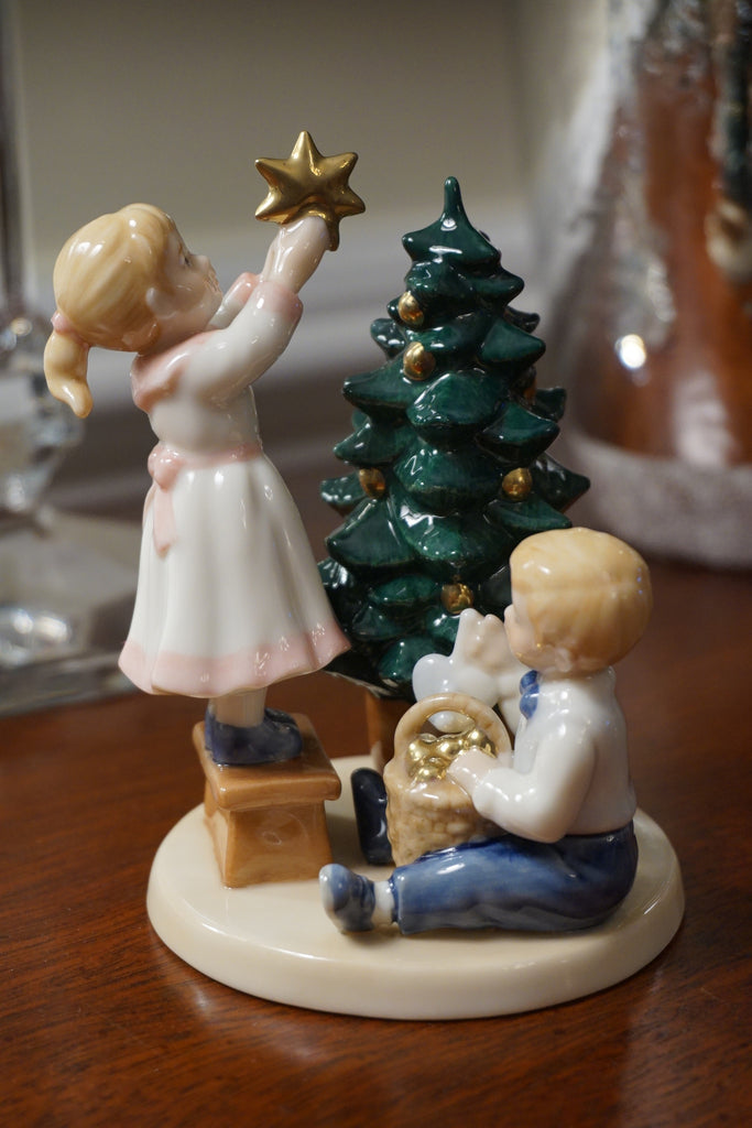 "Royal Copenhagen Clara and Peter ""Decorating the Christmas Tree"" porcelain figurine. Marked 150 on the bottom."