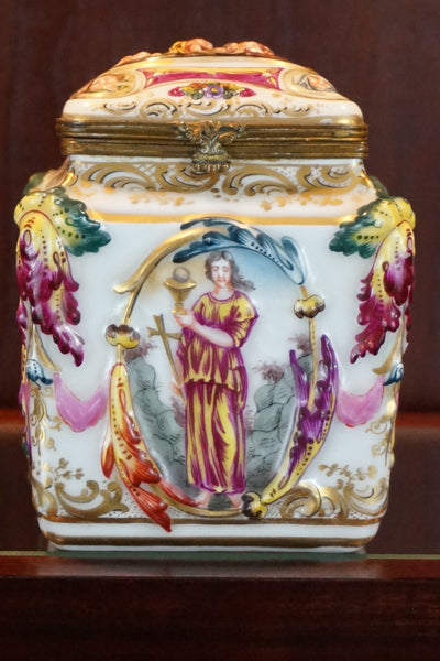 French Capodimonte enameled porcelain box with gilded cover.