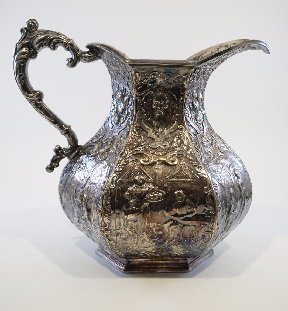 E. G. Webster Repousse Pitcher
