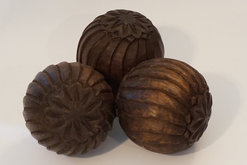 Three Carved Wooden Balls