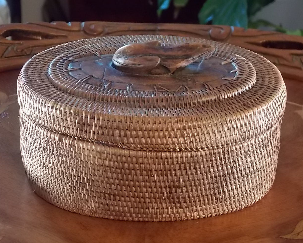 Hand-made basket with wooden frog on lid
