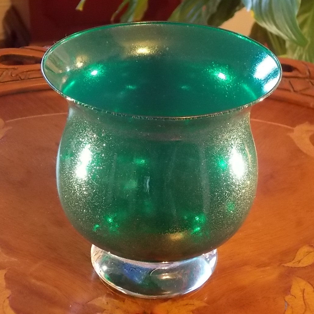 Green glass vase with gold sparkles