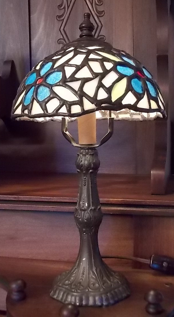 Stained glass table lamp on a cast metal bronze colored base