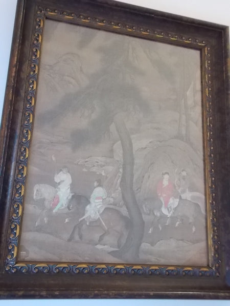 Antique looking Japanese prints that depict riders on horses - in ornate frame