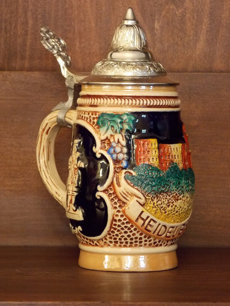 Original King German stein with pewter lid and raised design