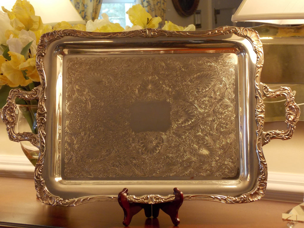 Silverplate over copper WM Rogers handled serving platter. Very ornate piece. Eagle star marked - pattern 290