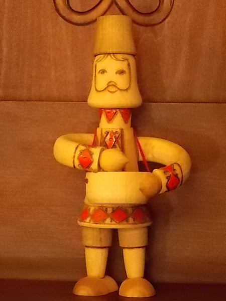 Wooden Russian man with bowl figurine