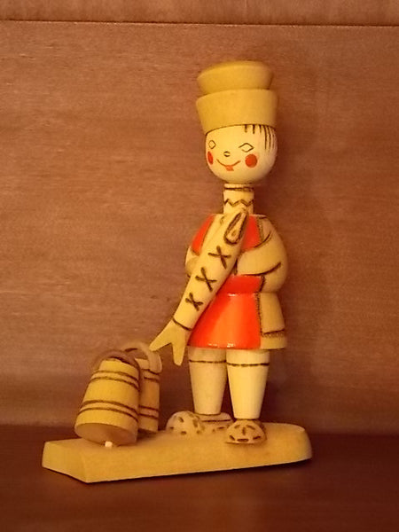 Russian wooden figurine of a boy with fish