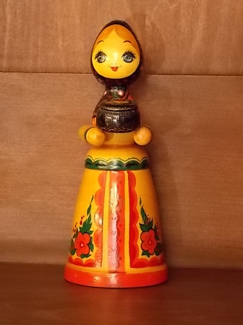 Hand-painted figurine of a Russian girl holding a pot