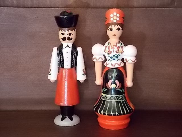 Russian wooden figurines of a man and woman couple dressed in traditional garb