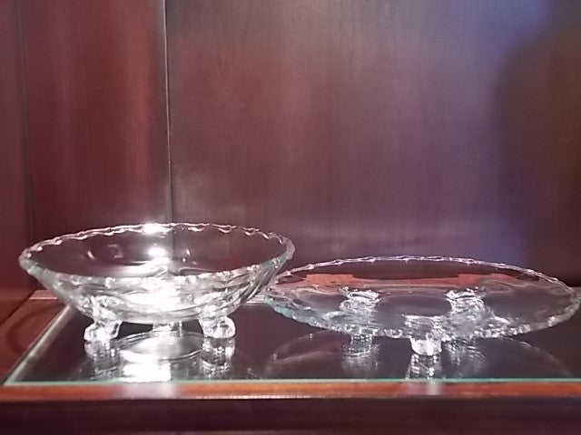 Clear glass footed bowl and plate with ruffled edges
