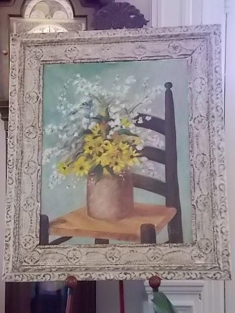 Framed painting of flowers displayed on an old chair, titled Grandmother's Chair