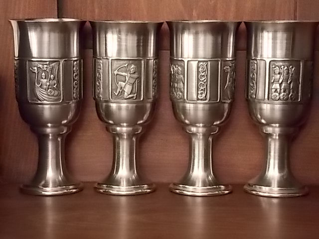 Four piece set of vintage Kongetinn pewter drinking cups