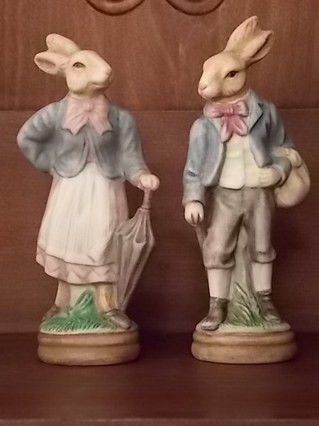 Pair of porcelain rabbits that appear to be inspired by Beatrix Potter stories