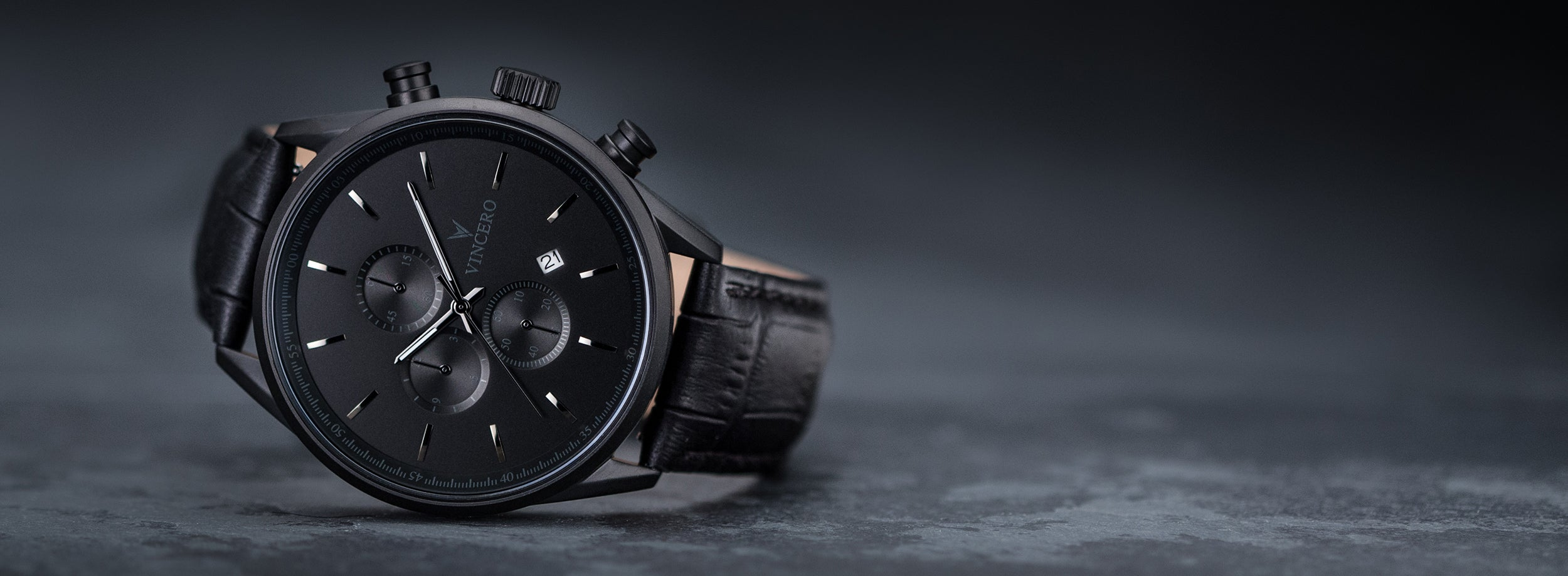 Close up of matte black watch in greyish black background