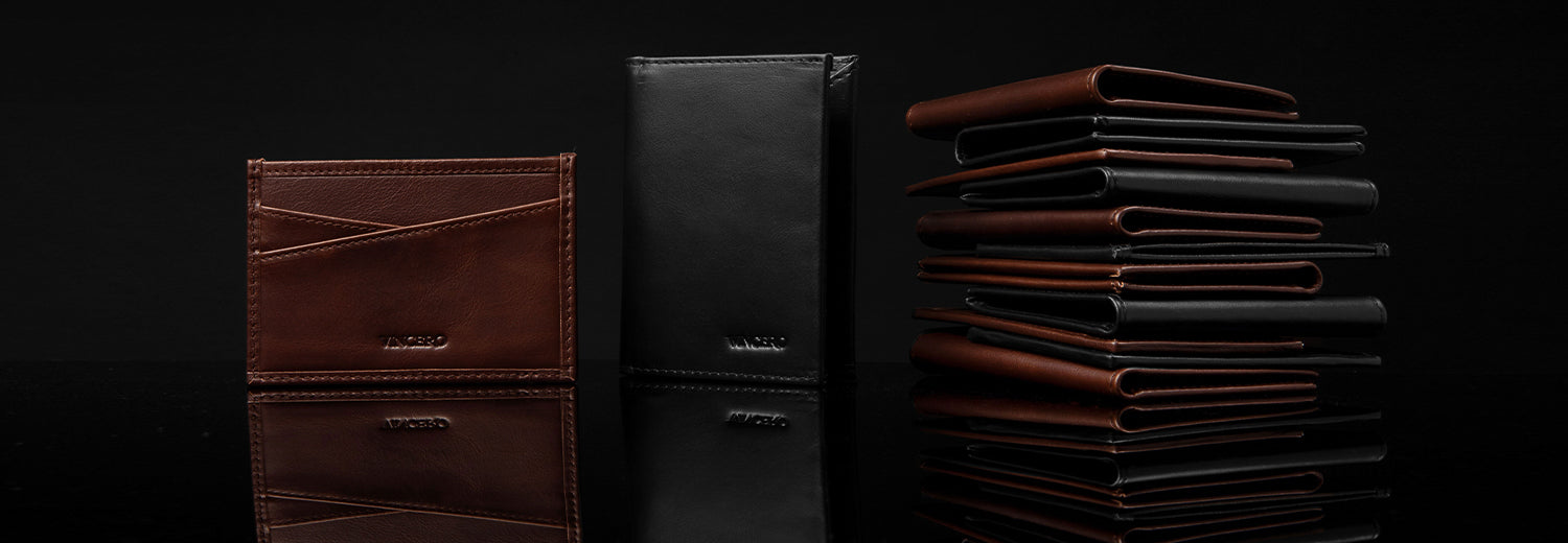 Brown wallet, black wallet, and stack of wallets with bottom reflection in black background