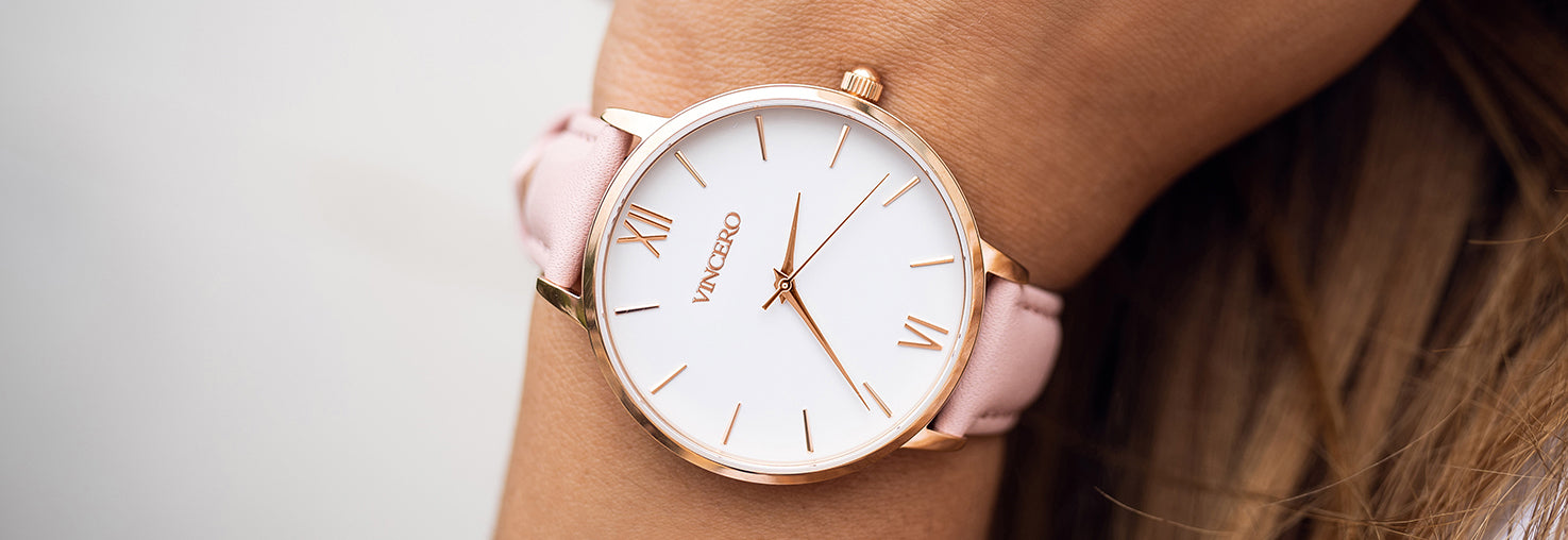 Close up of white and rose gold watch with rose pink leather strap
