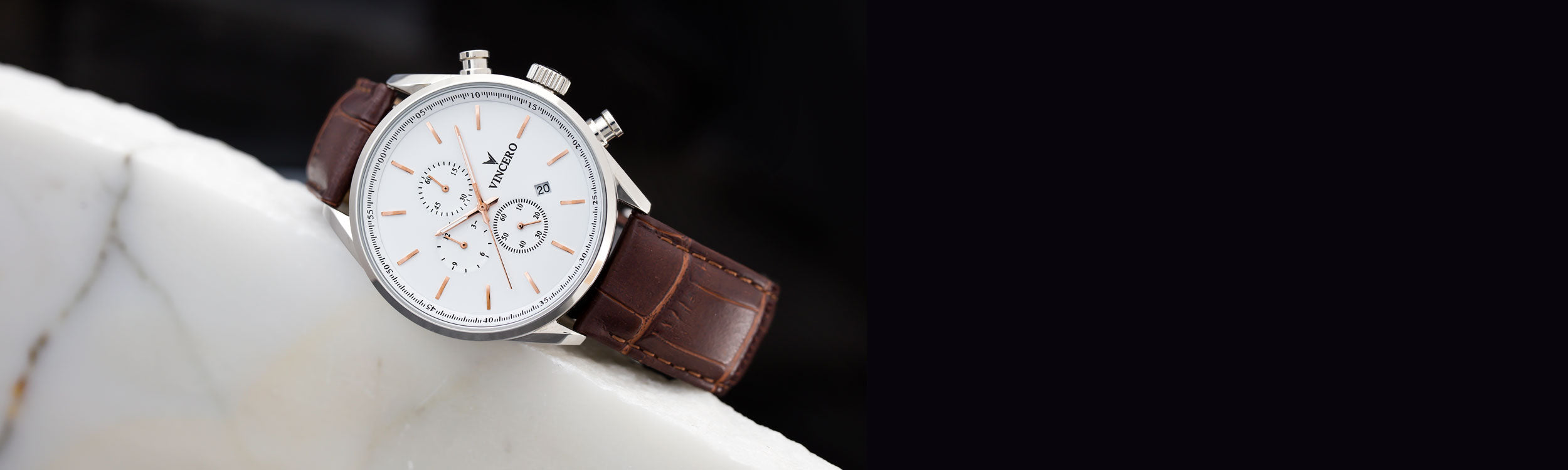 Brown and white watch leaning on white marble
