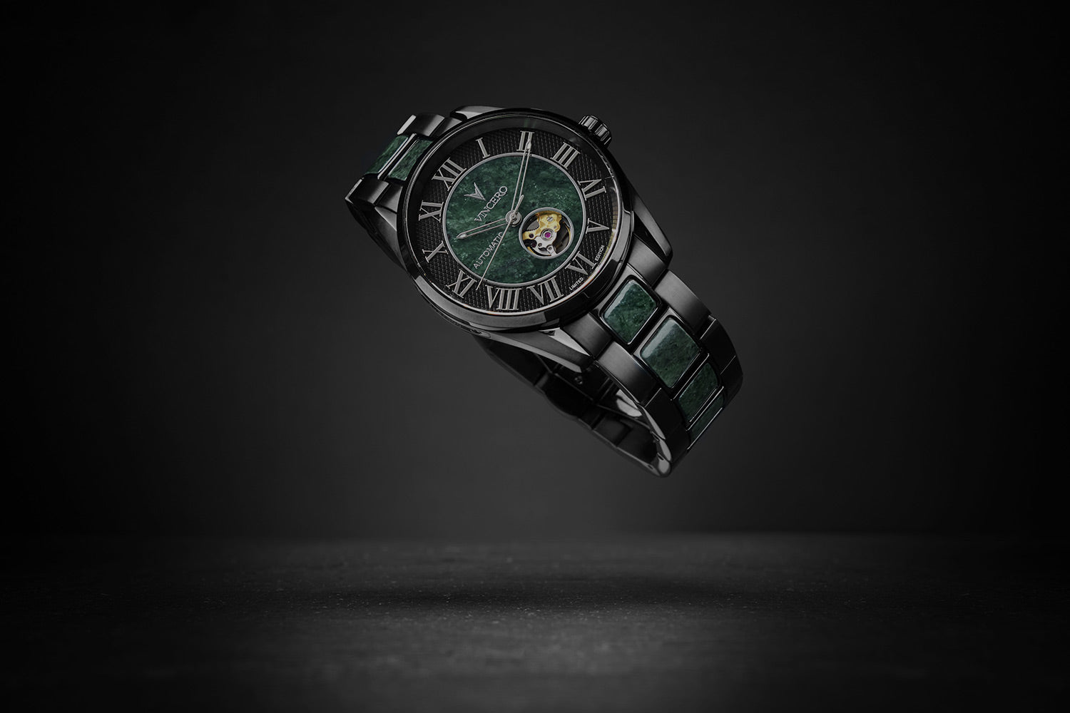 Watch with green marble center and black stainless steel strap with marble lining on black background