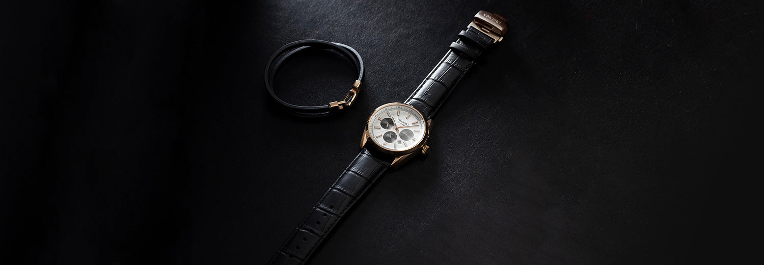 Five marble faced watches in black background