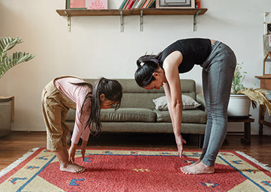 Photo of mom and daughter practicing yoga stretches by Ketut Subiyanto from Pexels
