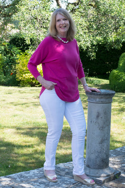 JUMPER WITH PEARL BUTTON BACK DETAIL, CURVED HEMLINE AND ROUNDED NECKLINE WITH 2 FRONT POCKETS