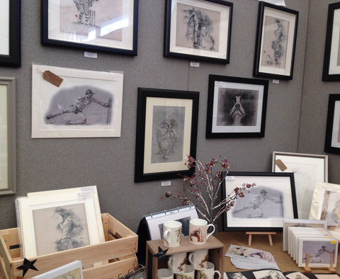 Close up of exhibition stall at art fair showing cricket and animal art