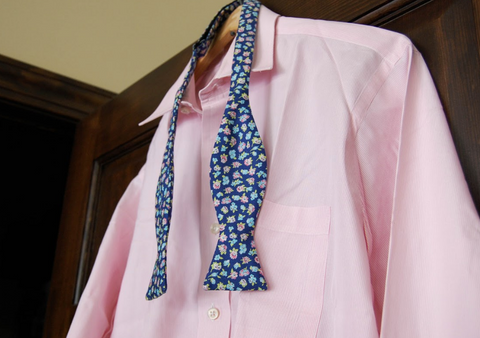 Floral bow tie styled with a pink dress shirt