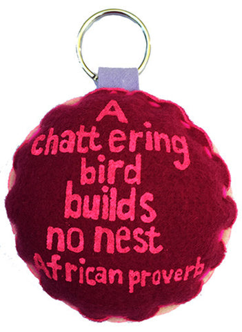 Handcrafted African Proverb two-toned felt keychain featuring image of a bird with text