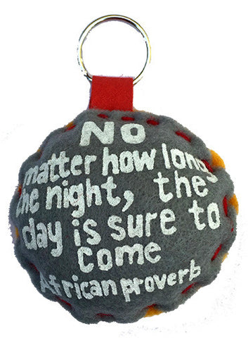 Handcrafted African Proverb two-toned felt keychain with ribbon featuring image of a rooster and text
