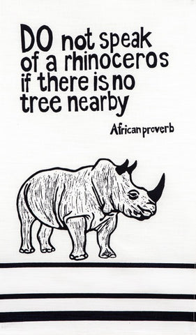 "fair trade hand printed african proverb tea towels feat. rhinoceros and text saying"" do not speak of a rhinoceros if there is no tree nearby"" in black"