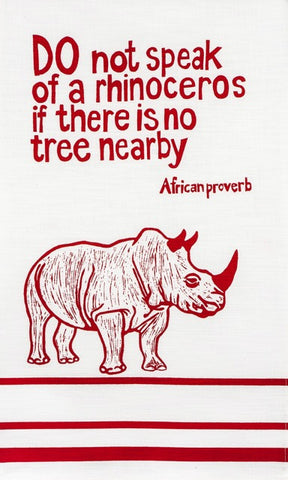 "fair trade hand printed african proverb tea towels feat. rhinoceros and text saying"" do not speak of a rhinoceros if there is no tree nearby"" in red"