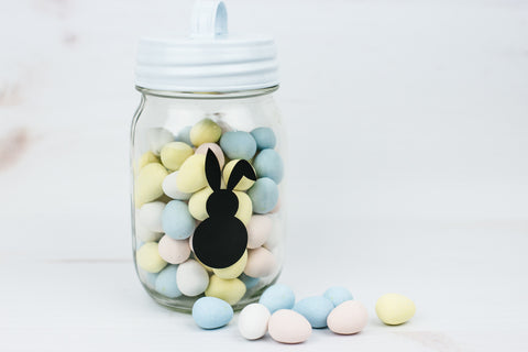 pint mason jar full of mini eggs with small Easter bunny decal on it