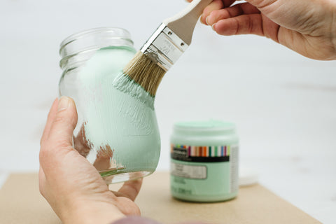 painting a pint mason jar with light aqua chalk paint