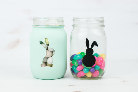 Easter bunny mason jars filled with Easter mini eggs and colorful jelly beans
