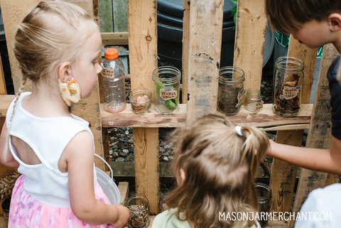 three kids selecting diy potions ingredients to make their own potions at a Harry Potter birthday party