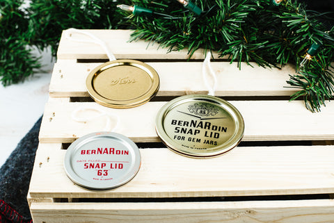 three handmade Christmas ornaments made from vintage flat mason jar lids