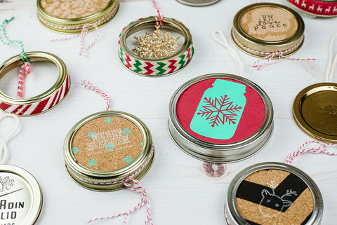 various DIY Christmas ornaments made from used mason jar flat lids and ring and scrapbooking paper