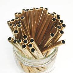 metallic gold stainless steel reusable straws in a mason jar