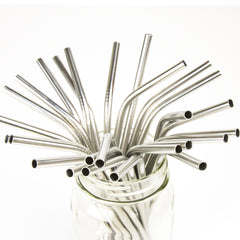 mason jar filled with bent silver stainless steel reusable straws