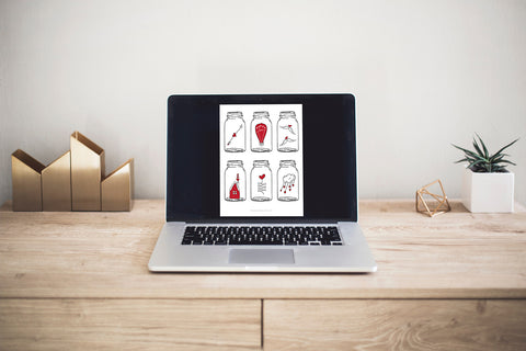 macbook open to a page of red and white free printable valentines