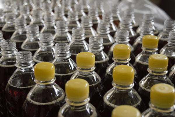 mass market production of plastic pop bottles with yellow plastic lids