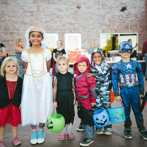 Group of kids wearing Halloween costumes source: Unsplash