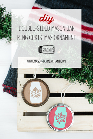 diy double-sided mason jar ring Christmas ornaments on a wooden crate next to an evergreen bow