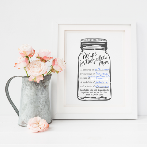 "Printable Freebie ""recipe for the perfect mom"" on display with light pink flowers."