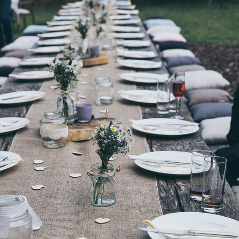 Long table wedding decor with mason jars and fresh flowers