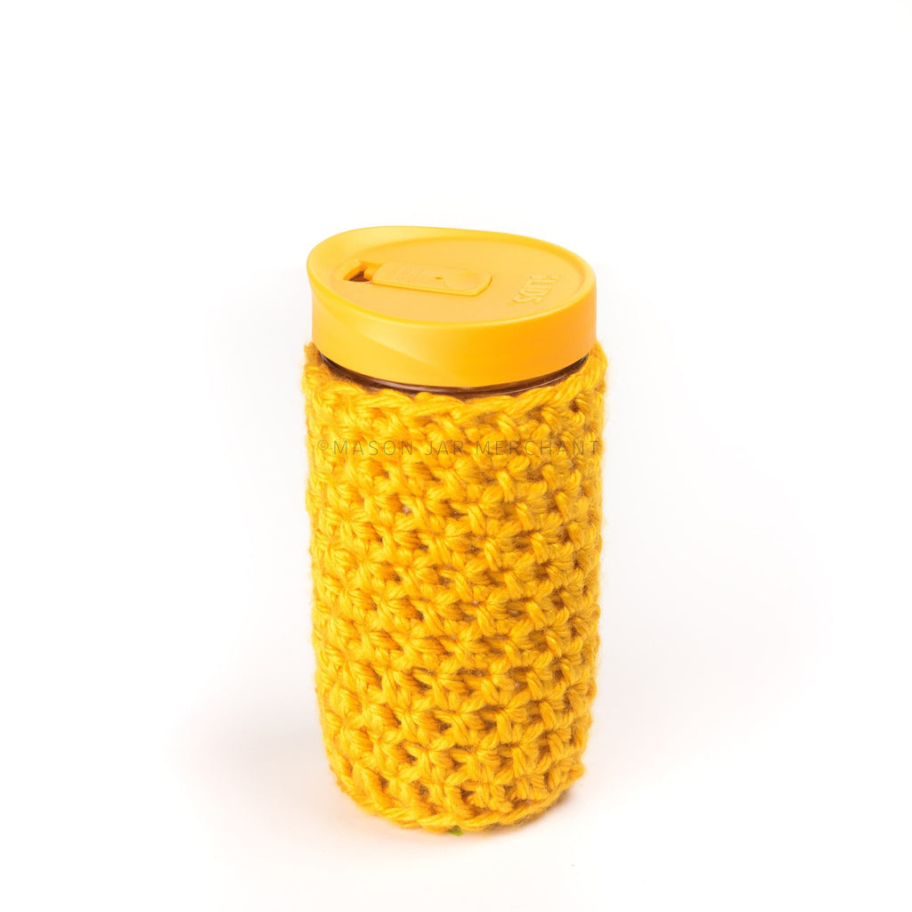 24 oz glass reusable mason jar tumbler with an all orange sippy cup lid. An orange knit cozy covers the jar