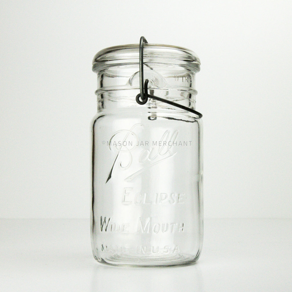 Vintage wire bail and glass lid quart mason jar with Ball Eclipse logo