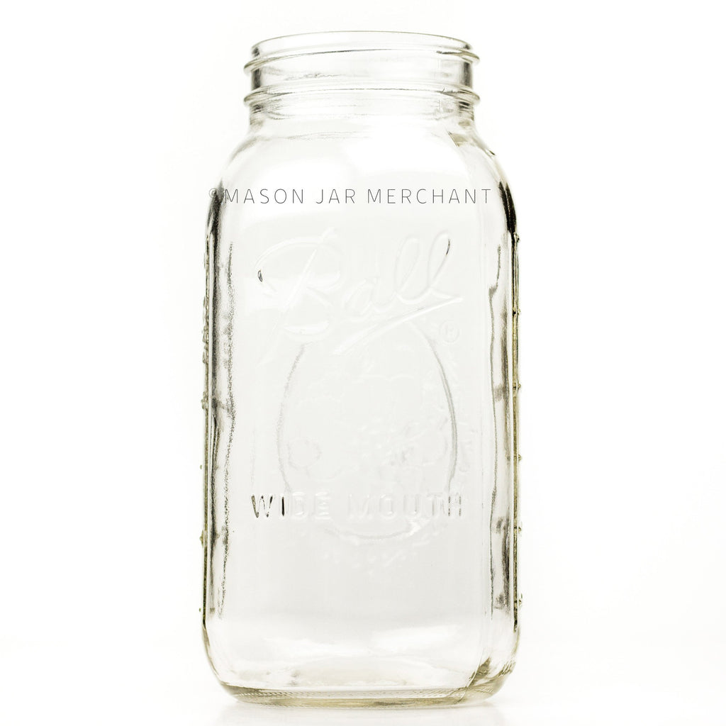 Wide mouth half-gallon mason jar with Ball Wide mouth logo, and fruity oval design visible on the back side of the jar. against a white background