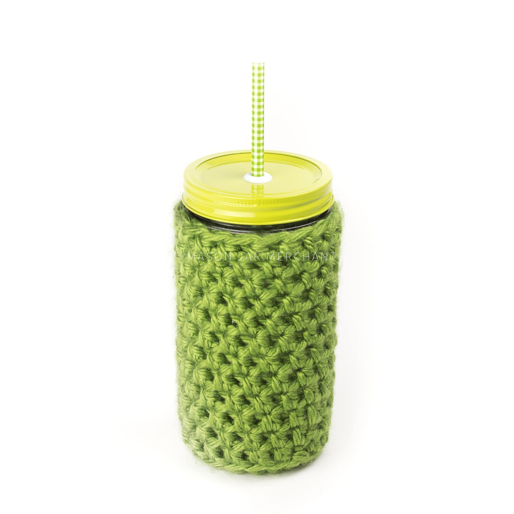 24 oz reusable glass mason jar tumbler with an all lime green straw lid and a green and white gingham reusable straw. A green knit cozy covers the jar